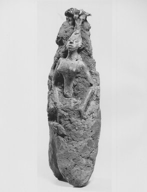 Fon. <em>Female Figure in Investment</em>, late 19th or early 20th century. Clay, copper alloy, 7 1/2 x 2 3/4 x 2 in. (19.0 x 6.9 x 5.1 cm). Brooklyn Museum, Museum Collection Fund, 50.125.12. Creative Commons-BY (Photo: Brooklyn Museum, CUR.50.125.12_print_threequarter_bw.jpg)
