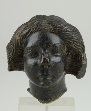 <em>Female Head</em>, 250 C.E.-300 C.E. Steatite, 2 15/16 x max. diam. 2 11/16 in. (7.4 x 6.8 cm). Brooklyn Museum, Gift of Albert Gallatin, 50.60. Creative Commons-BY (Photo: Brooklyn Museum (in collaboration with Index of Christian Art, Princeton University), CUR.50.60_view1_ICA.jpg)