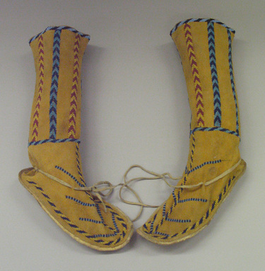 Apache (possibly Mescalero). <em>High Beaded Boots</em>, 19th century. Hide, rawhide, beads, 12 1/4 x 4 1/2 x 9 1/2 in. (31.1 x 11.4 x 24.1 cm). Brooklyn Museum, Henry L. Batterman Fund and Frank Sherman Benson Fund, 50.67.25a-b. Creative Commons-BY (Photo: Brooklyn Museum, CUR.50.67.25a-b_view1.jpg)