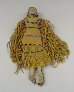 Apache, White Mountain. <em>Stuffed Doll with Two-piece Dress, Boots and Beaded Barette</em>, late 19th century. Cloth, hide, beads, 12 1/2 in. (31.8 cm). Brooklyn Museum, Henry L. Batterman Fund and the Frank Sherman Benson Fund, 50.67.32. Creative Commons-BY (Photo: Brooklyn Museum, CUR.50.67.32_view1.jpg)