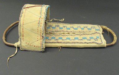 Apache. <em>Beaded Cradleboard</em>, 1801-1900. Wood, hide, tin, beads, 22 3/4 in. (57.8 cm). Brooklyn Museum, Henry L. Batterman Fund and the Frank Sherman Benson Fund, 50.67.33. Creative Commons-BY (Photo: Brooklyn Museum, CUR.50.67.33_view1.jpg)