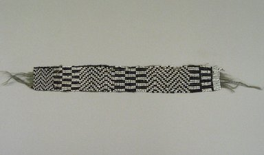 Chippewa (Anishinaabe). <em>Garter</em>, early 19th century. Yarn, garnet beads, pony beads, 11 3/4 x 1 11/16 in. (29.8 x 4.3 cm). Brooklyn Museum, Henry L. Batterman Fund and the Frank Sherman Benson Fund, 50.67.37a. Creative Commons-BY (Photo: Brooklyn Museum, CUR.50.67.37a.jpg)