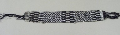 Chippewa (Anishinaabe). <em>Garter</em>, early 19th century. Yarn, garnet beads, pony beads, 11 x 1 11/16 in.  (27.9 x 4.3 cm). Brooklyn Museum, Henry L. Batterman Fund and the Frank Sherman Benson Fund, 50.67.37b. Creative Commons-BY (Photo: Brooklyn Museum, CUR.50.67.37b.jpg)
