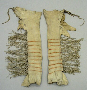 Yanktonai, Nakota, Sioux. <em>Pair of Red and Brown Striped Leggings for Chief's Dress</em>, early 19th century. Buckskin, pigment, sinew, Each: 37in. (94cm). Brooklyn Museum, Henry L. Batterman Fund and Frank Sherman Benson Fund, 50.67.3b-c. Creative Commons-BY (Photo: Brooklyn Museum, CUR.50.67.3b-c_view1.jpg)