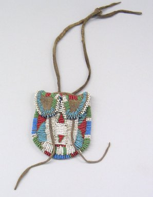 Plains (Eastern). <em>Beaded Pouch</em>, late 19th century. Hide, beads, 3 1/4 x 2 3/4 in. (8.3 x 7 cm). Brooklyn Museum, Henry L. Batterman Fund and the Frank Sherman Benson Fund, 50.67.40. Creative Commons-BY (Photo: Brooklyn Museum, CUR.50.67.40_view1.jpg)