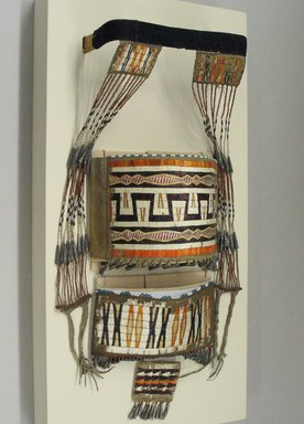 Sioux. <em>Model Cradle Decorations</em>, 1801-1836. Wood, hide, porcupine and bird quills, tin cones, glass beads, wool cloth, Including mount: 7 × 12 × 24 1/8 in. (17.8 × 30.5 × 61.3 cm). Brooklyn Museum, Henry L. Batterman Fund and the Frank Sherman Benson Fund, 50.67.44. Creative Commons-BY (Photo: Brooklyn Museum, CUR.50.67.44_view1.jpg)