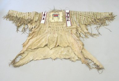 Blackfoot, Piegan. <em>Chief's Warrior Shirt</em>, early 19th century. Hide, quills, hair, beads, pigment, cloth, cotton thread, 44 x 69 1/4 in. (111.8 x 175.9 cm). Brooklyn Museum, Henry L. Batterman Fund and Frank Sherman Benson Fund, 50.67.5a. Creative Commons-BY (Photo: Brooklyn Museum, CUR.50.67.5a_view1.jpg)