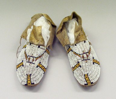 Cheyenne. <em>Pair of Moccasins worn in dance</em>, before 1900. Hide, beads, 11 x 3 15/16 in.  (28.0 x 10.0 cm). Brooklyn Museum, Gift of Dr. L.W. Rork, 51.103. Creative Commons-BY (Photo: Brooklyn Museum, CUR.51.103.jpg)