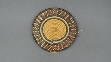 Hausa. <em>Flat Coiled Basketry Cover for a Pot</em>, early 20th century. Vegatable fiber, diam: 5 1/2 in. (14.0 cm). Brooklyn Museum, Gift of John W. Vandercook, 51.140.25. Creative Commons-BY (Photo: Brooklyn Museum, CUR.51.140.25_top.jpg)
