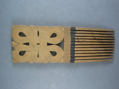Djuka. <em>Comb</em>, ca. 1920. Wood, 8 7/16 x 2 15/16 in. (21.5 x 7.5 cm). Brooklyn Museum, Gift of John W. Vandercook, 51.140.9. Creative Commons-BY (Photo: Brooklyn Museum, CUR.51.140.9_bottom.jpg)