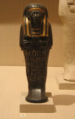 <em>Shabty of Neferptah</em>, ca. 1352-1279 B.C.E. Serpentine, pigment, gold, Height 8 11/16 in. (22 cm). Brooklyn Museum, Charles Edwin Wilbour Fund, 52.72. Creative Commons-BY (Photo: Brooklyn Museum, CUR.52.72_wwgA-3.jpg)