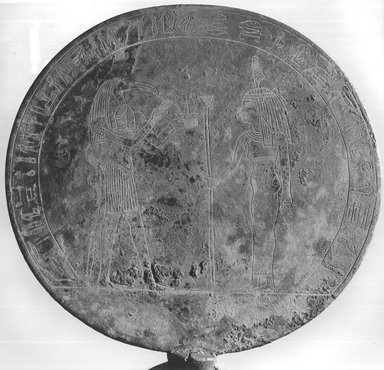 <em>Votive Mirror</em>, ca. 200 B.C.E. Bronze, wood, Disk: 6 7/8 x 7 5/8 in. (17.5 x 19.4 cm). Brooklyn Museum, Charles Edwin Wilbour Fund, 52.73. Creative Commons-BY (Photo: Brooklyn Museum, CUR.52.73_print_negA_bw.jpg)