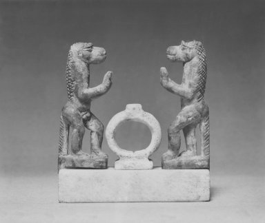 <em>Two Apes on Base with Amulet</em>, 305 B.C.E.-100 C.E. Stone, marble, Apes: 1 7/8 in. (4.8 cm). Brooklyn Museum, Charles Edwin Wilbour Fund, 52.74a-d. Creative Commons-BY (Photo: Brooklyn Museum, CUR.52.74_NegA_print_bw.jpg)
