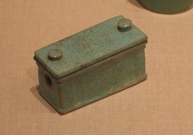 <em>Model of a Toilet Box with Cover</em>, 305-30 B.C.E. Faience, glazed, 1 5/8 x 1 1/4 x 2 3/4 in. (4.2 x 3.2 x 7 cm). Brooklyn Museum, Charles Edwin Wilbour Fund, 53.81a-b. Creative Commons-BY (Photo: Brooklyn Museum, CUR.53.81a-b_wwg8.jpg)