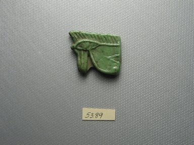 <em>Wadjet-eye Amulet</em>, 305–30 B.C.E. Glass, 1 3/16 x 1/4 x 1 1/2 in. (3 x 0.7 x 3.8 cm). Brooklyn Museum, Charles Edwin Wilbour Fund, 53.89. Creative Commons-BY (Photo: Brooklyn Museum, CUR.53.89_view1.jpg)