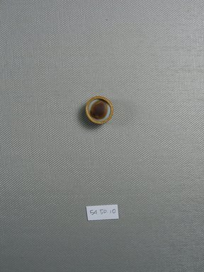 <em>One of Fifteen Circular Stones</em>, ca. 410 B.C.E. Gold, agate, 3/8 x Diam: 3/4 in. (1 x Diam: 1.9 cm). Brooklyn Museum, Charles Edwin Wilbour Fund, 54.50.10. Creative Commons-BY (Photo: Brooklyn Museum, CUR.54.50.10_view1.jpg)