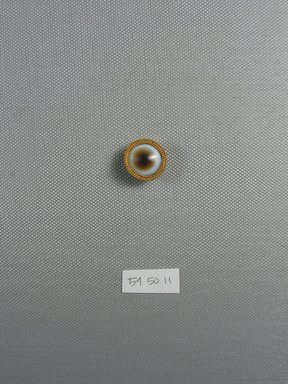 <em>One of Fifteen Circular Stones</em>, ca. 410 B.C.E. Gold, agate, 5/16 x Diam: 3/4 in. (0.8 x Diam: 1.9 cm). Brooklyn Museum, Charles Edwin Wilbour Fund, 54.50.11. Creative Commons-BY (Photo: Brooklyn Museum, CUR.54.50.11_view1.jpg)