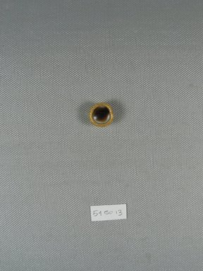 <em>One of Fifteen Circular Stones</em>, ca. 410 B.C.E. Gold, agate, 1/4 x Diam: 11/16 in. (0.7 x Diam: 1.7 cm). Brooklyn Museum, Charles Edwin Wilbour Fund, 54.50.13. Creative Commons-BY (Photo: Brooklyn Museum, CUR.54.50.13_view1.jpg)