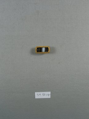 <em>One of Five Rectangular Stones</em>, ca. 410 B.C.E. Gold, agate, 7/16 x 5/16 x 13/16 in. (1.1 x 0.8 x 2.1 cm). Brooklyn Museum, Charles Edwin Wilbour Fund, 54.50.17. Creative Commons-BY (Photo: Brooklyn Museum, CUR.54.50.17_view1.jpg)