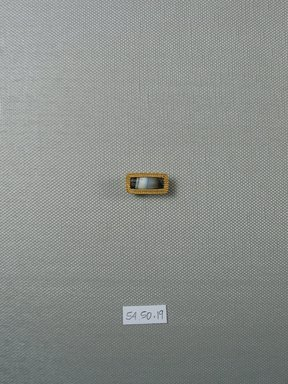 <em>One of Five Rectangular Stones</em>, 5th-4th century B.C.E. Gold, agate, 3/8 x 1/4 x 3/4 in. (1 x 0.7 x 2 cm). Brooklyn Museum, Charles Edwin Wilbour Fund, 54.50.19. Creative Commons-BY (Photo: Brooklyn Museum, CUR.54.50.19_view1.jpg)