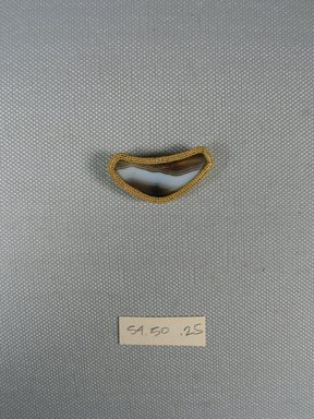 <em>One of Eleven Triangular Stones</em>, ca. 410 B.C.E. Gold, agate, 5/8 x 3/16 x 1 3/8 in. (1.6 x 0.6 x 3.5 cm). Brooklyn Museum, Charles Edwin Wilbour Fund, 54.50.25. Creative Commons-BY (Photo: Brooklyn Museum, CUR.54.50.25_view1.jpg)
