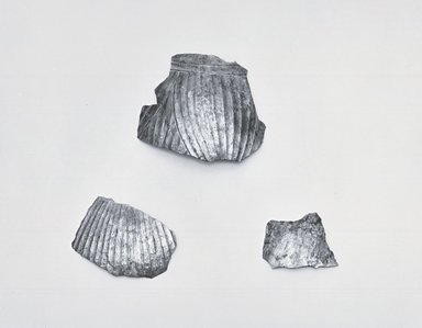<em>Three Fragments from Body of Decorated Jug</em>, ca. 410 B.C.E. Silver, (Fragment a): 2 13/16 x 3 3/8 in. (7.1 x 8.5 cm). Brooklyn Museum, Charles Edwin Wilbour Fund, 54.50.43a-c. Creative Commons-BY (Photo: Brooklyn Museum, CUR.54.50.43a-c_NegGRPA_print_bw.jpg)