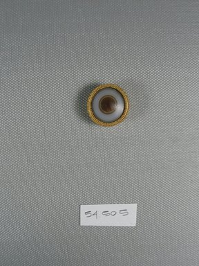 <em>One of Fifteen Circular Stones</em>, ca. 410 B.C.E. Gold, agate, 3/8 x Diam: 7/8 in. (0.9 x Diam: 2.2 cm). Brooklyn Museum, Charles Edwin Wilbour Fund, 54.50.5. Creative Commons-BY (Photo: Brooklyn Museum, CUR.54.50.5_view1.jpg)