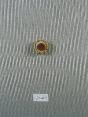 <em>One of Fifteen Circular Stones</em>, ca. 410 B.C.E. Gold, agate, 5/16 x Diam: 13/16 in. (0.9 x Diam: 2 cm). Brooklyn Museum, Charles Edwin Wilbour Fund, 54.50.9. Creative Commons-BY (Photo: Brooklyn Museum, CUR.54.50.9_view1.jpg)