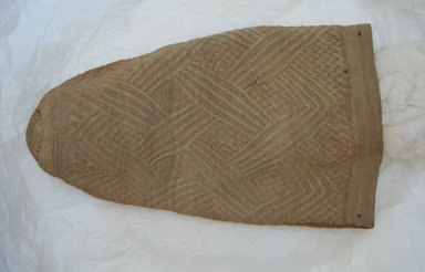 Kongo. <em>Prestige cap (mpu)</em>. Plant fiber, 6 5/16 x 14 3/16 in. (16 x 36 cm). Brooklyn Museum, Gift of Adelaide Goan, 55.96.131. Creative Commons-BY (Photo: Brooklyn Museum, CUR.55.96.131.jpg)
