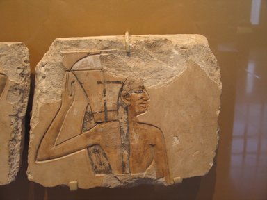 <em>Royal Offering Bearer</em>, ca. 2008-1957 B.C.E. Limestone, pigment, 9 5/16 x 11 1/4 in. (23.7 x 28.5 cm). Brooklyn Museum, Charles Edwin Wilbour Fund, 56.126. Creative Commons-BY (Photo: Brooklyn Museum, CUR.56.126_erg2.jpg)