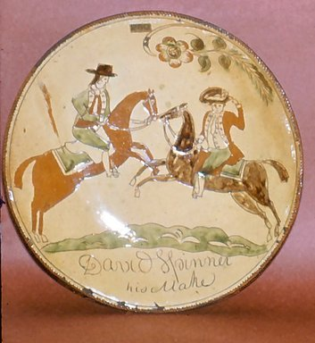 David Spinner (American, 1758-1811). <em>Pie Plate</em>, ca. 1800. Glazed earthenware, Height: 2 in.  (5.1 cm);. Brooklyn Museum, Gift of Huldah Cail Lorimer in memory of George Burford Lorimer, 56.5.2. Creative Commons-BY (Photo: Brooklyn Museum, CUR.56.5.2.jpg)