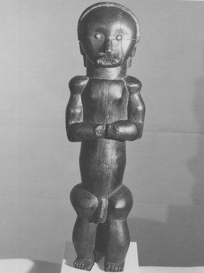 Ntumu Fang. <em>Reliquary Guardian Figure (Eyema Bieri)</em>, late 19th or early 20th century. Wood, applied materials, oil, copper alloy, 20 1/16 x 5 1/2 x 5 1/4in. (51 x 14 x 13.3cm). Brooklyn Museum, Gift of Arturo and Paul Peralta-Ramos, 56.6.100. Creative Commons-BY (Photo: Brooklyn Museum, CUR.56.6.100_print_front_bw.jpg)
