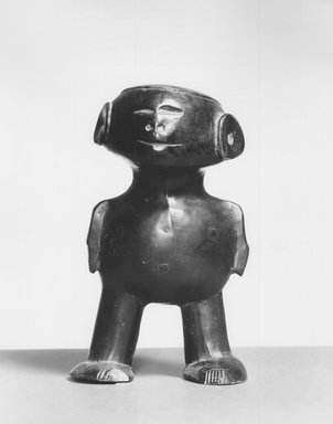 Unknown. <em>Standing Figure</em>, early 20th century. Stone, 6 1/4 x 3 1/9 x 3 1/5 in. (16.2 x 9.9 x 8.9 cm). Brooklyn Museum, Gift of Arturo and Paul Peralta-Ramos, 56.6.38. Creative Commons-BY (Photo: Brooklyn Museum, CUR.56.6.38_print_front_bw.jpg)