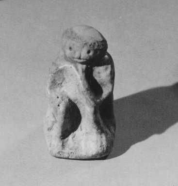 <em>Statuette of a Seated Boy? or Man?</em>, ca. 3100-2800 B.C.E. Faience, 2 1/4 × 1 3/8 × 1 5/8 in. (5.7 × 3.5 × 4.1 cm). Brooklyn Museum, Charles Edwin Wilbour Fund, 57.165.6. Creative Commons-BY (Photo: Brooklyn Museum, CUR.57.165.6_NegID_57.165.2_GRPA_print_cropped_bw.jpg)