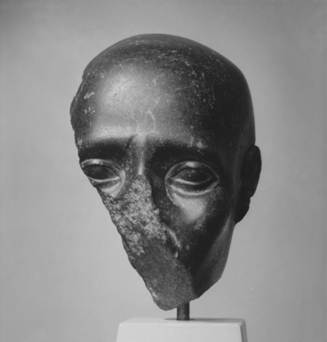 <em>Fragment of a Head with Shaven Skull</em>, 4th-3rd century B.C.E. Basalt, 5 3/8 × 4 3/4 × 2 3/8 in. (13.7 × 12.1 × 6 cm). Brooklyn Museum, Charles Edwin Wilbour Fund, 57.42. Creative Commons-BY (Photo: , CUR.57.42_NegA_print_bw.jpg)