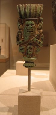 <em>Protective God</em>, ca. 945-718 B.C.E. Faience, 5 15/16 x 2 1/2 x 15/16 in. (15.1 x 6.4 x 2.4 cm). Brooklyn Museum, Charles Edwin Wilbour Fund, 58.171. Creative Commons-BY (Photo: Brooklyn Museum, CUR.58.171_wwg8.jpg)