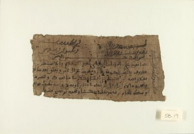 <em>Papyrus Fragment</em>, ca. 10th century C.E. Ink on papyrus, 3 3/8 x 6 3/4 in. (8.6 x 17.2 cm). Brooklyn Museum, Gift of Michel Abemayor, 58.91 (Photo: Brooklyn Museum, CUR.58.91_IMLS_PS5.jpg)