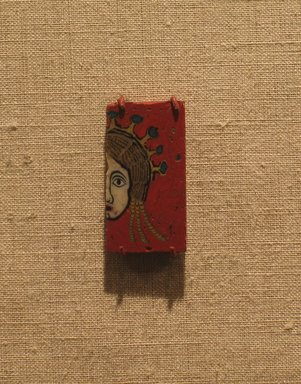 <em>Plaque with Half of a Female Head</em>, 100 B.C.E.-100 C.E. Fused mosaic glass, 1 1/8 x 5/8 in. (2.9 x 1.6 cm). Brooklyn Museum, Charles Edwin Wilbour Fund, 58.93.3. Creative Commons-BY (Photo: Brooklyn Museum, CUR.58.93.3_wwg8.jpg)