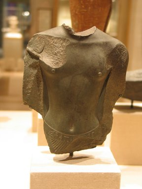 <em>Torso of a Saite King</em>, ca. 664-570 B.C.E. Schist, 6 1/16 x 4 13/16 x 1 9/16 in. (15.4 x 12.2 x 4 cm). Brooklyn Museum, Charles Edwin Wilbour Fund, 58.95. Creative Commons-BY (Photo: Brooklyn Museum, CUR.58.95_wwg8.jpg)