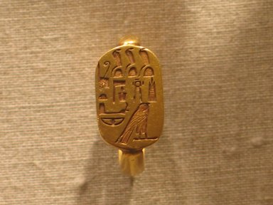 <em>Ring with Protective Inscription</em>, ca. 664-342 B.C.E. Gold with copper overlays, 13/16 in. (2.1 cm). Brooklyn Museum, Charles Edwin Wilbour Fund, 58.96. Creative Commons-BY (Photo: Brooklyn Museum, CUR.58.96_wwg8.jpg)