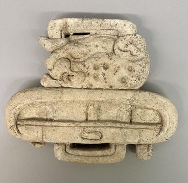 Maya. <em>Glyph Representing Head of Jaguar and Katun</em>, 647 C.E. Stucco, 8 3/4 × 10 5/8 × 1 1/4 in. (22.2 × 27 × 3.2 cm). Brooklyn Museum, By exchange, 59.237.8. Creative Commons-BY (Photo: Brooklyn Museum, CUR.59.237.8.jpg)