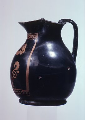 Apulian. <em>Red Figure Chous</em>, middle of the 4th century B.C.E. Clay, slip, 5 5/8 x Diam. 4 7/16 in. (14.3 x 11.3 cm). Brooklyn Museum, Gift of Joseph V. Noble, 60.129.1. Creative Commons-BY (Photo: Brooklyn Museum, CUR.60.129.1_view1.jpg)