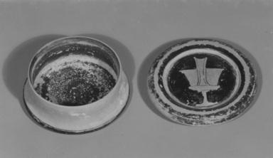 Greek. <em>Red-Figure Pyxis</em>, 4th century B.C.E. Clay, slip, 1 1/16 x Diam. 2 5/8 in. (2.7 x 6.7 cm). Brooklyn Museum, Gift of Joseph V. Noble, 60.129.2a-b. Creative Commons-BY (Photo: , CUR.60.129.2a-b_NoNeg_print_bw.jpg)