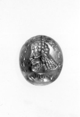 Sasanian. <em>Magic Gem</em>, 3rd-4th century C.E. Carnelian, base: 1/2 x 9/16 in. (1.2 x 1.5 cm). Brooklyn Museum, Gift of E. Manus, 60.179. Creative Commons-BY (Photo: Brooklyn Museum, CUR.60.179_negA_bw.jpg)