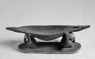 <em>Boat-Shaped Carving</em>, 20th century. Wood, pigment, 2 9/16 x 8 11/16 in. (6.5 x 22 cm). Brooklyn Museum, Museum Collection Fund, 60.52.4. Creative Commons-BY (Photo: Brooklyn Museum, CUR.60.52.4_bw.jpg)