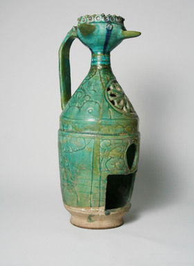 <em>Oil Lamp or Lantern</em>, 12th-13th century (possibly). Decorated clay, H: 13 1/2 in. (34.3 cm). Brooklyn Museum, Gift of Mrs. Edward A. Behr, 61.118.4. Creative Commons-BY (Photo: Brooklyn Museum, CUR.61.118.4_view1.jpg)