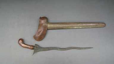 <em>Kris and Scabbard</em>. Iron, wood, brass, 5 7/8 x 19 11/16 in. (15 x 50 cm). Brooklyn Museum, Gift of Mr. and Mrs. Emanuel H. Lavine, 62.4.5a-b. Creative Commons-BY (Photo: Brooklyn Museum, CUR.62.4.5a-b.jpg)