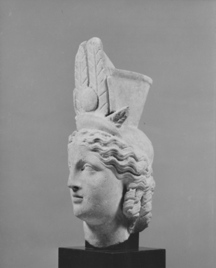 <em>Head of Isis-Fortuna</em>, 1st century B.C.E.- 2nd century C.E. Marble, 14 x 8 7/16 x 5 1/2 in. (35.5 x 21.5 x 14 cm). Brooklyn Museum, Charles Edwin Wilbour Fund, 62.45. Creative Commons-BY (Photo: Brooklyn Museum, CUR.62.45_NegB_print_bw.jpg)