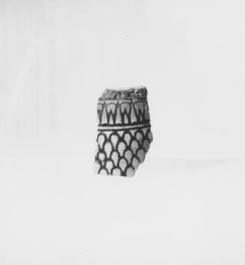 <em>Fragment of a Vessel</em>, ca. 1390-1352 B.C.E. Faience, 1 1/2 x 1 in. (3.9 x 2.5 cm). Brooklyn Museum, Gift of Michael Abemayor, 62.98.2. Creative Commons-BY (Photo: , CUR.62.98.2_NegA_print_bw.jpg)