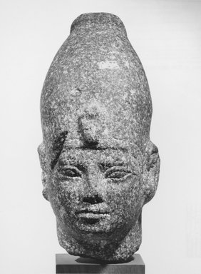 <em>Male Head</em>. Granite, 8 11/16 x 4 7/16 x 4 15/16 in. (22 x 11.2 x 12.5 cm). Brooklyn Museum, Gift of Albert Gallatin, 64.1.1. Creative Commons-BY (Photo: Brooklyn Museum, CUR.64.1.1_NegA_print_bw.jpg)